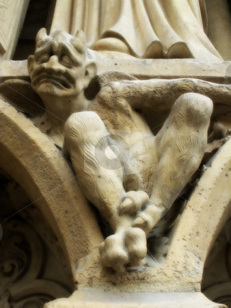 Unhappy fellow stock photo, Grimacing gargoyle on the Church of Notre Dam in Paris, France by Cora Reed