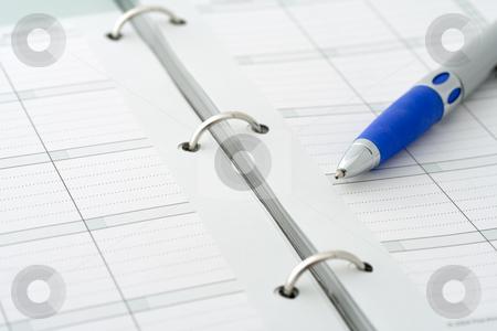 Ballpoint pen on notebook stock photo, Close-up of ballpoint pen on open notebook by Natalia Banegas