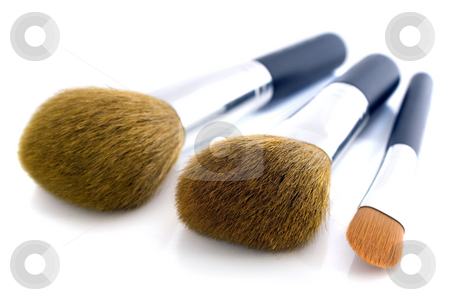 Set of three makeup brushes stock photo, Set of three makeup brushes for face powder, concealer and eye shadow.  Isolated on white background, with shadow. by Natalia Banegas