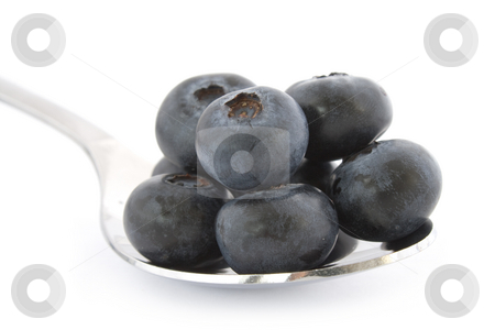 Spoon with fresh blueberries stock photo, Spoon with fresh blueberries isolated on white background with shadow. by Natalia Banegas