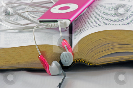 Bible and Headphones stock photo, In the modern age, more people are download audio versions of the Bible. by Jim Larranaga