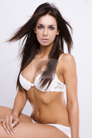 Sexy girl stock photo, Sexy brunette woman wearing nice lingerie. Isolated over white background by Piotr Stryjewski