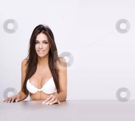 Sexy girl stock photo, The young girl in underwear sitting on the isolated table by Piotr Stryjewski