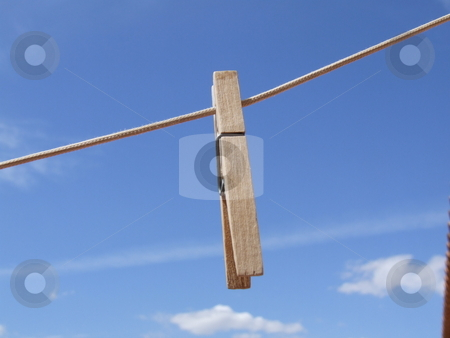 Single Cloths Peg with Blue Sky Background stock photo, Single Cloths Peg with Blue Sky Background by Stephen Lambourne
