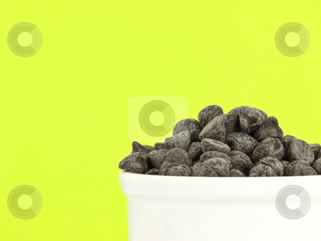Chocolate chips on green stock photo, Chocolate chips on green background with copy space by John Teeter