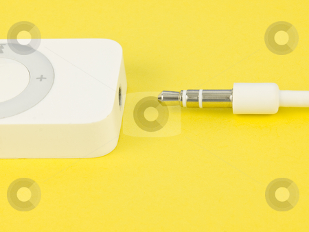 Plug on yellow stock photo, Plug with music player on yellow background by John Teeter