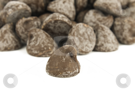 Chocolate chip pile stock photo, Pile of Chocolate Chips on a White Background by John Teeter
