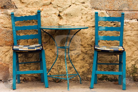In Kardamili... stock photo, Blue table and chairs in a country coffee shop, against a highly textured wall. Image captured in southern Greece. by Andreas Karelias