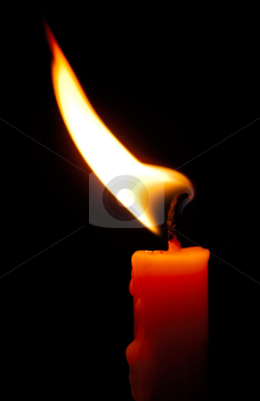 Candle in the wind stock photo, Image shows a red candle with a shimmering flame by Andreas Karelias