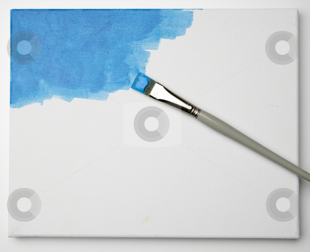 Blue painting stock photo, Artist uses brush to paint a canvas blue by James Barber