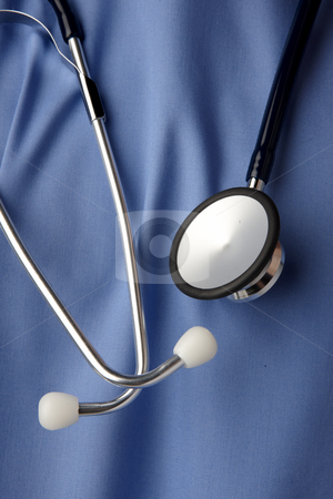 Blue hospital scrubs stock photo, Close up of blue hospital scrubs with stethoscope by James Barber