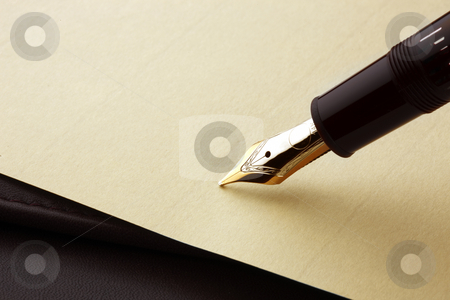 Fountain pen on parchment paper stock photo, Fountain pen about to write on parchment paper by James Barber