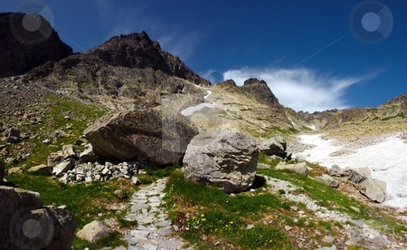 Walking path with boulders stock photo, Walking path in mountains with big boulders by Juraj Kovacik