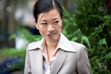 Asian Business Woman stock photo, An attractive Asian woman dressed in business attire. by Todd Arena