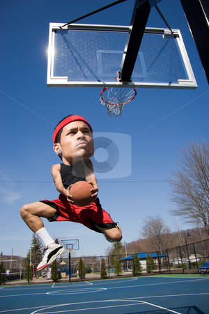 Big Head Basketball Player stock photo, A basketball player with a large head driving to the hoop with some fancy moves. by Todd Arena