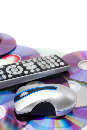 Home Theatre Montage stock photo, Remote control and computer mouse over a bed of dvd disks isolated over white. by Todd Arena
