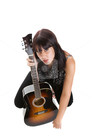 Female musician stock photo, Wide angle view of a pretty musician with a guitar by Steve Mcsweeny