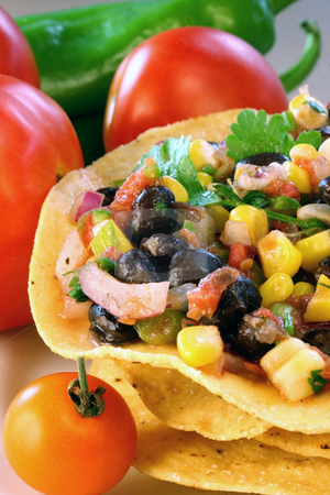 Black Bean and Corn Salsa stock photo, Black bean and corn salsa on tostados by Linda Schhirmbeck