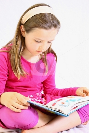 Young cute girl with pink dress reading book. stock photo, Young reading book by Gregory Dean