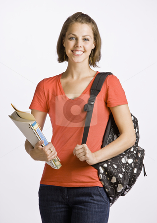 Student carrying backpack and books stock photo, Student carrying backpack and books by Jonathan Ross