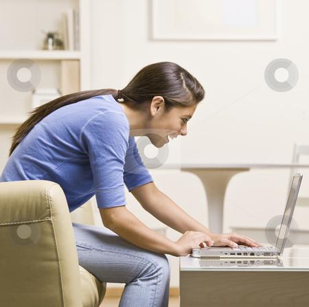 Teenage girl using laptop stock photo, Teenage girl using laptop by Jonathan Ross