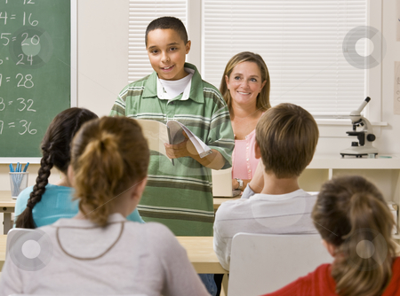 Student giving report in classroom stock photo, Student giving report in classroom by Jonathan Ross
