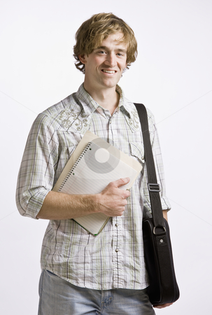 Student carrying books and briefcase stock photo, Student carrying books and briefcase by Jonathan Ross