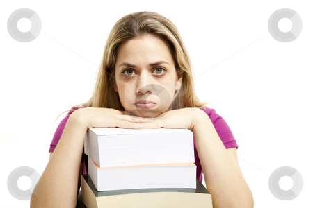 Young woman with books stock photo, Young woman that has bored from a lot of studing by Marios Karampalis