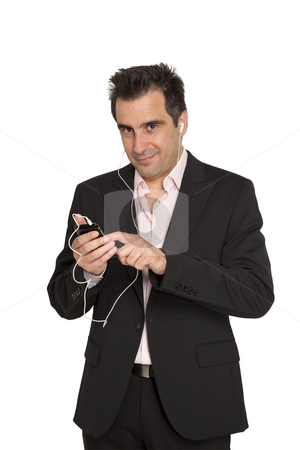 Businessman with mp3 player stock photo, Businessman in suit that hears music from mp3 player by Marios Karampalis