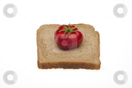 A tomato on a slice bread with path stock photo, A small tomato on a slice bread for toasty of total milling by Marios Karampalis