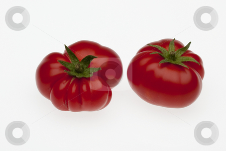? stock photo, Two biologically cultivated tomatoes, small size with hand made clipping path by Marios Karampalis