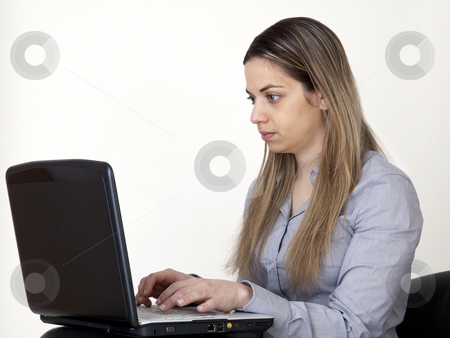Young women with laptop stock photo, Young girl, writes in her computer by Marios Karampalis