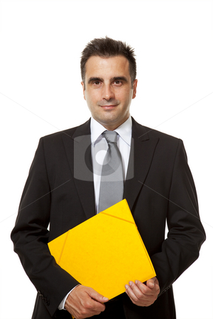 Businessman holds a yellow file  stock photo, Businessman holds a yellow file from his office by Marios Karampalis