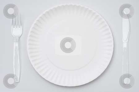 Paper plate stock photo, Empty singleuse white paper plate with set of clear plastic fork and knife on white background or tablecloth by Yuriy Nijnik