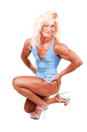 Bodybuilding woman. stock photo, An blond bodybuilding girl kneeling on the floor of a studio and shooing her very muscular body with high heels and blouse top and shorts, over white. by Horst Petzold