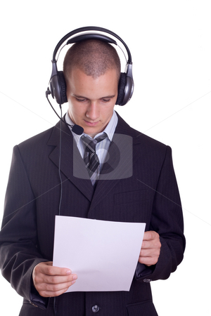 Young businessman stock photo, Young businessman from a help desk service by Istv??n Cs??k