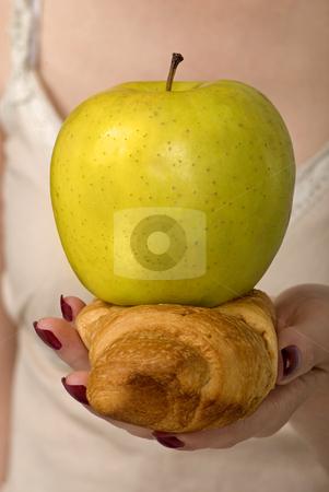 Dilemma - Apple Or Croissant stock photo, Healthy lifestyle dilemma - apple or croissant by Desislava Draganova