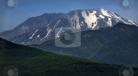Mount Saint Helens in back of Green Mountains Washington stock photo, Snow Covered Mount Saint Helens in Back of Green Mountains by William Perry