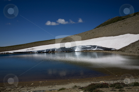 Frozen Lake, Sunrise, Mount Rainier stock photo, Frozen Lake, Sunrise, Mount Rainier, Snow in August, National Park Water with Reflection by William Perry