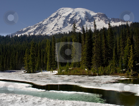Icy Reflection Lake Mount Rainier stock photo, Icy Reflection Lake, Mount Rainier National Park in June thawing by William Perry
