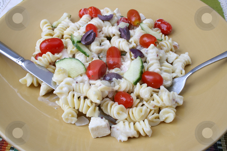 Caesar Salad with Cutlery stock photo, Cold Pasta Salad with tomatoes, cucumbers and olives by Vanessa Van Rensburg