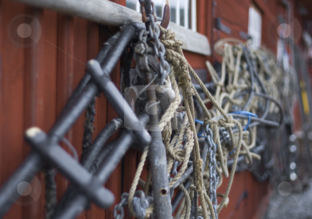 Rope stock photo, Rope hanging on a wodden house wall by Fredrik Elfdahl