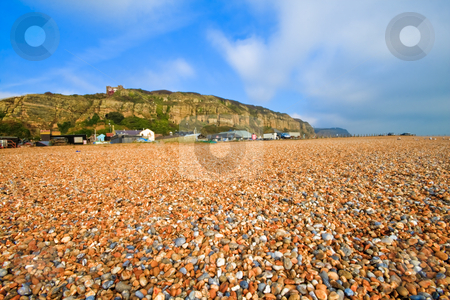 Beach stock photo, Beach in the foreground and hill in the background by Fredrik Elfdahl