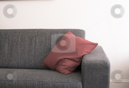 Couch stock photo, Couch with red pillow by Fredrik Elfdahl