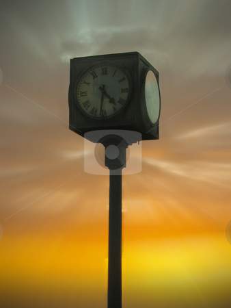Clock in the sky stock photo, A clock in the foreground and sunset in the background by Fredrik Elfdahl