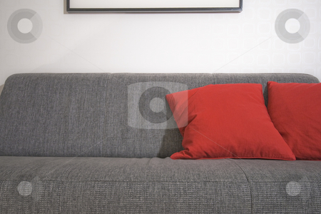 Couch and red pillow stock photo, A couch and red pillow by Fredrik Elfdahl