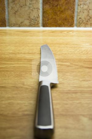 Knife stock photo, Sharp knife on a kitchen bench by Fredrik Elfdahl