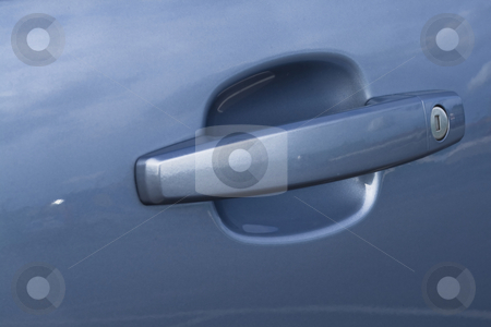 Car handle with a lock in a close up stock photo, Car handle with a lock in a close up by Fredrik Elfdahl