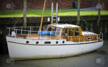 Ship on land stock photo, Old ship laying on land by Fredrik Elfdahl