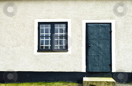 Door and Window stock photo, A door and a window on a stone wall by Fredrik Elfdahl